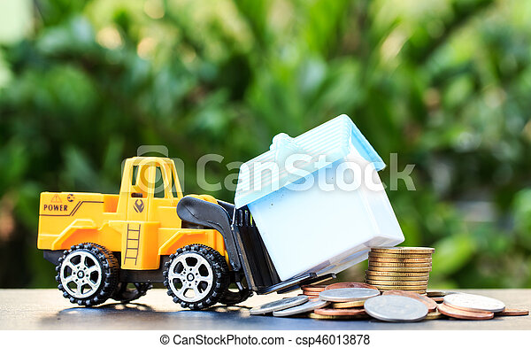 Forklift truck delivering coins to buy a house