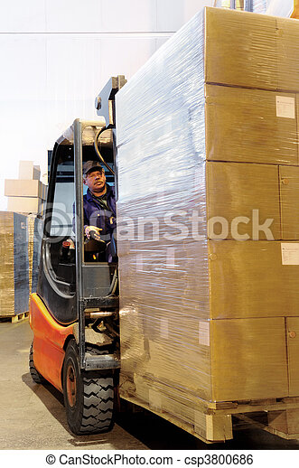 forklift worker in loader at warehouse - csp3800686
