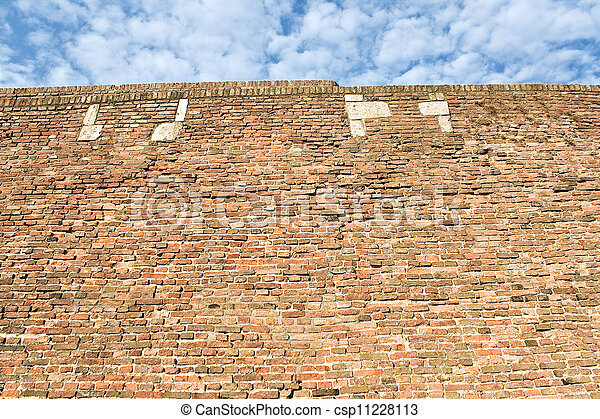 Fortress brick wall and sky as background - csp11228113