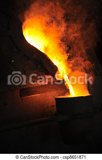 Foundry - molten metal poured from ladle for casting - csp8651871