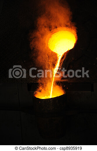 Foundry - molten metal poured from ladle for casting - csp8935919