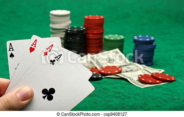 Four aces with gambling chips over green felt - csp9408127