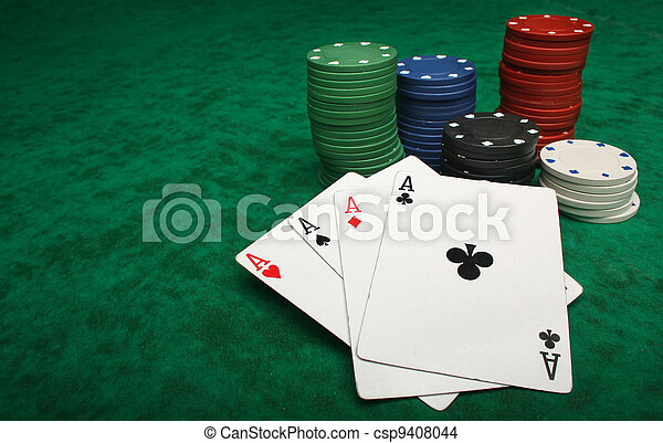 Four aces with gambling chips over green felt - csp9408044