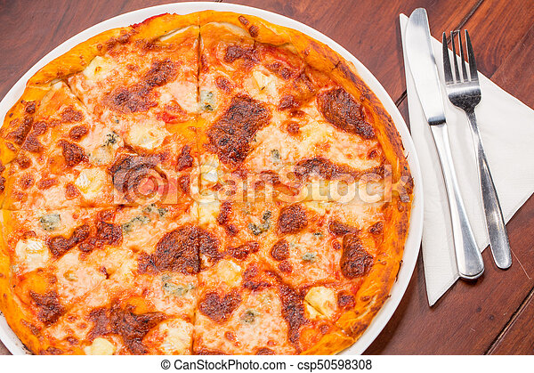 Four Cheese Pizza Top View With Wooden Table   Csp50598308