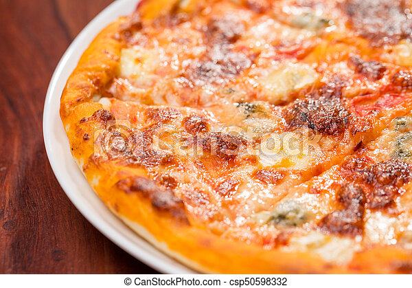Four Cheese Pizza Top View With Wooden Table   Csp50598332