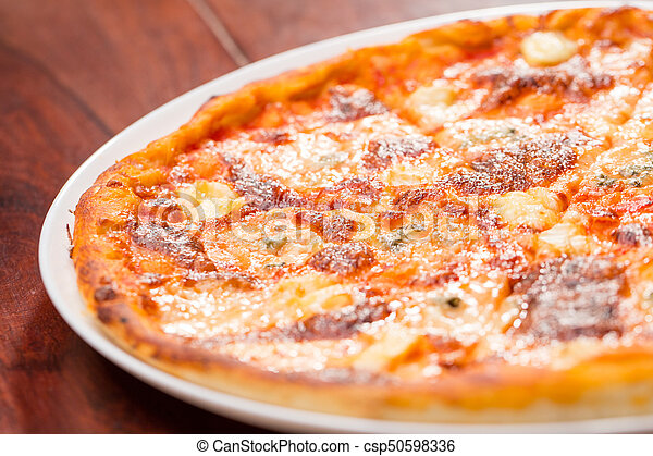 Four Cheese Pizza Top View With Wooden Table   Csp50598336