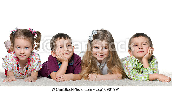 Four children lying on the carpet - csp16901991