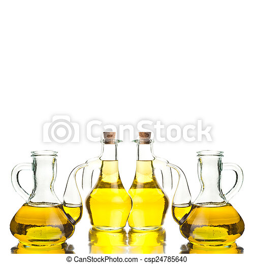 Four glass bottles with extra olive oil - csp24785640