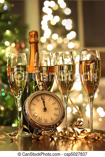 Four glasses of champagne ready for the New Year - csp5027837