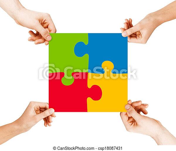four hands connecting puzzle pieces - csp18087431