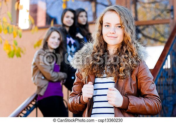 Four happy teen girls friends - csp13360230