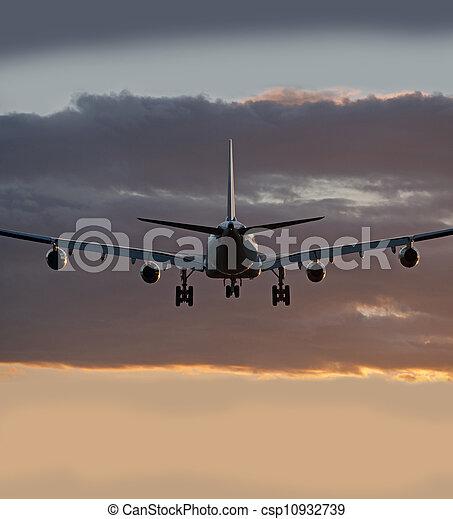 Four jet engine aircraft before landing - csp10932739