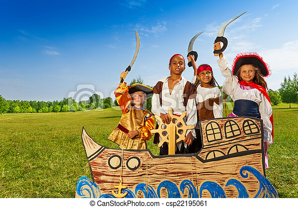 Four kids in pirate costumes behind ship - csp22195061