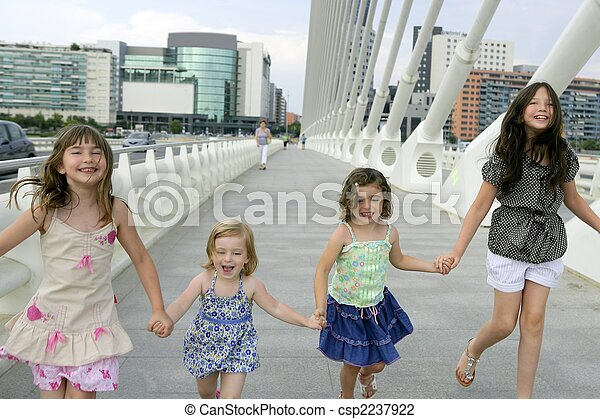 Four little girl group walking in the city - csp2237922