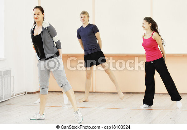 Four people in gym - csp18103324