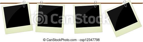 Four polaroid photos hanging on rop - csp12347798