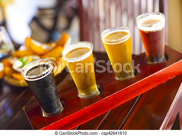 Four sorts of beer. Beer tasting. Ale, porter, lager, pilsner - csp42641610