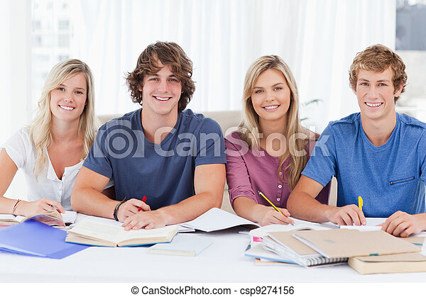 Four students looking at the camera - csp9274156