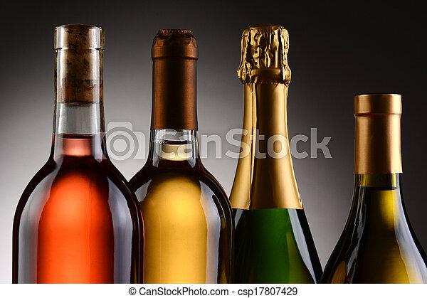 Four Wine Bottles Backlit - csp17807429