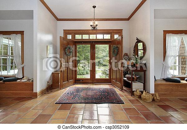 Foyer with orange ceramic floors - csp3052109