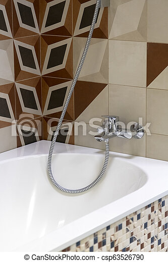 Fragment of a bathroom with the mixer - csp63526790