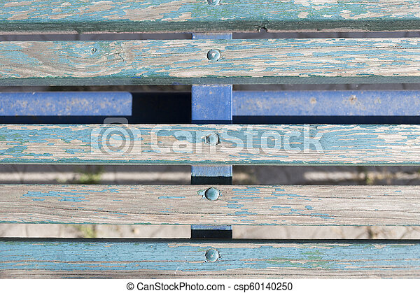Fragment of a old wooden bench. Clopse-up. - csp60140250