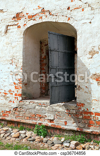 Fragment of an old wall with a window - csp36704856