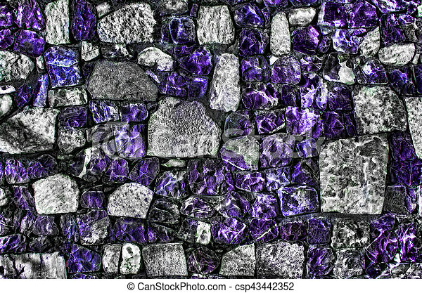 Fragment of old brick wall with river stones texture white grey brown black green blue lime yellow orange maroon violet pink turquoise colored background, different type of stones mosaic surface - csp43442352