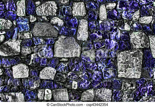 Fragment of old brick wall with river stones texture white grey brown black green blue lime yellow orange maroon violet pink turquoise colored background, different type of stones mosaic surface - csp43442354