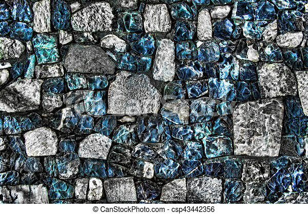 Fragment of old brick wall with river stones texture white grey brown black green blue lime yellow orange maroon violet pink turquoise colored background, different type of stones mosaic surface - csp43442356