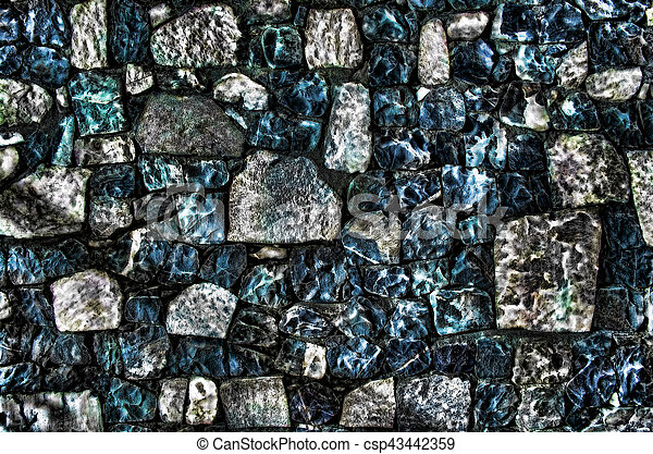Fragment of old brick wall with river stones texture white grey brown black green blue lime yellow orange maroon violet pink turquoise colored background, different type of stones mosaic surface - csp43442359