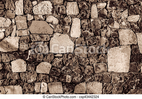 Fragment of old brick wall with river stones texture white grey brown black green blue lime yellow orange maroon violet pink turquoise colored background, different type of stones mosaic surface - csp43442324