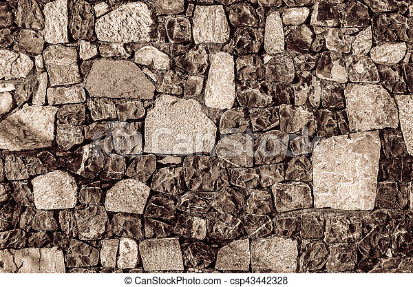 Fragment of old brick wall with river stones texture white grey brown black green blue lime yellow orange maroon violet pink turquoise colored background, different type of stones mosaic surface - csp43442328