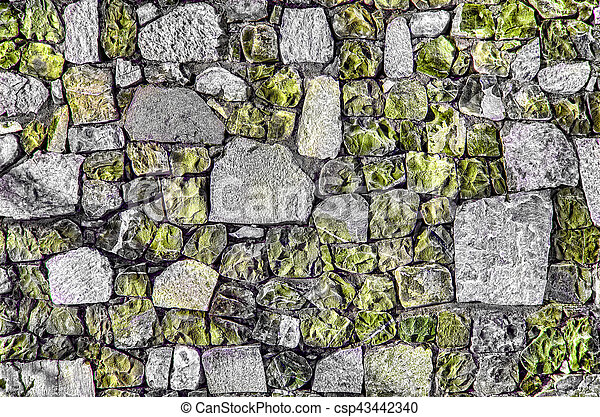 Fragment of old brick wall with river stones texture white grey brown black green blue lime yellow orange maroon violet pink turquoise colored background, different type of stones mosaic surface - csp43442340