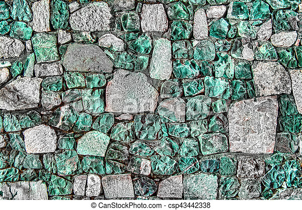 Fragment of old brick wall with river stones texture white grey brown black green blue lime yellow orange maroon violet pink turquoise colored background, different type of stones mosaic surface - csp43442338