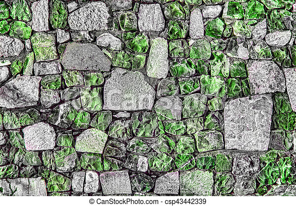 Fragment of old brick wall with river stones texture white grey brown black green blue lime yellow orange maroon violet pink turquoise colored background, different type of stones mosaic surface - csp43442339