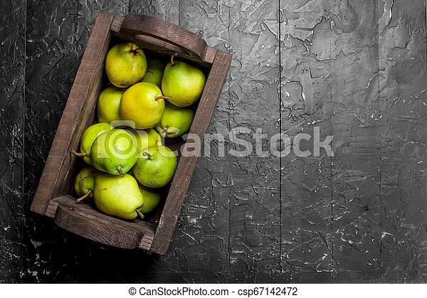 Fragrant ripe pears in the box. - csp67142472