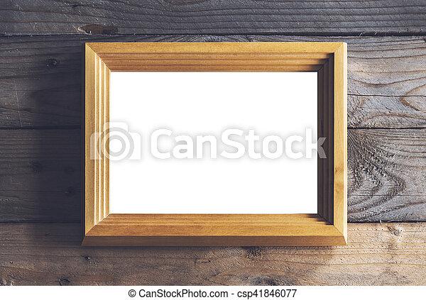 Frame mockup on rustic wood. Image of rustic wooden frame mock up.