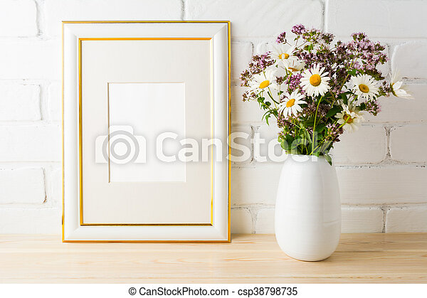 249655aba278 Frame mockup with wild flowers bouquet. portrait or poster white frame  mockup. empty white frame mockup for presentation artwork.