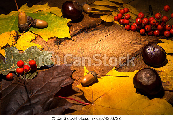 Frame of Autumn maple leaves on aged wood with copy space. Mockup for seasonal offers and holiday post card, - csp74266722