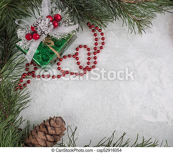 Frame of branches and new year decor on snow-covered glass. New ...