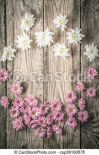 Frame Of White And Pink Flowers On The Wooden Background Vertical