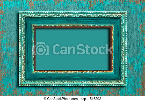Frame on a vintage blue wall. - csp11516392