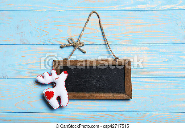 Frame on the blue wooden background - csp42717515