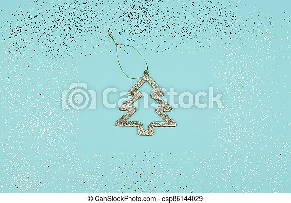 Frame with Christmas tree on blue background. Festive greeting card for new year - csp86144029