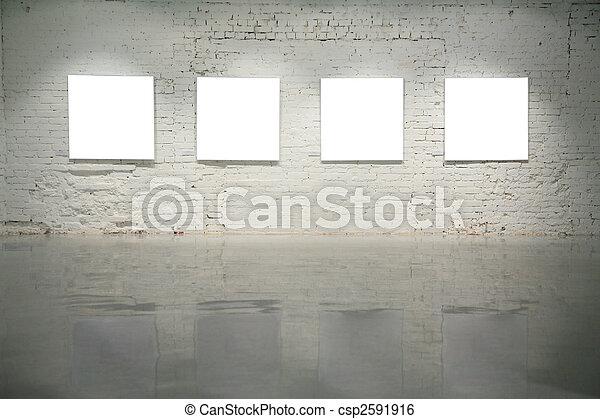 frames on white brick wall - csp2591916