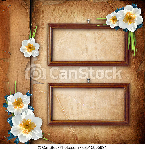 Framework for photo with spring flowers over old paper album cover   - csp15855891
