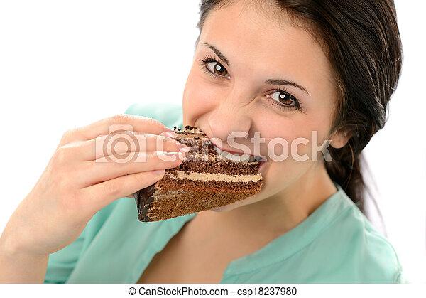 Gierige junge Frau isst leckeren Kuchen - csp18237980