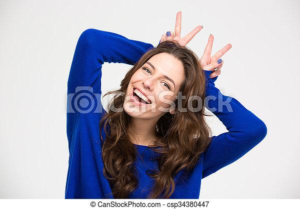 frau, sie, hände, hörner, spaß, machen, lächeln, haben - csp34380447