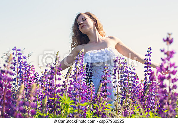 Free woman in the field of lupines - csp57960325